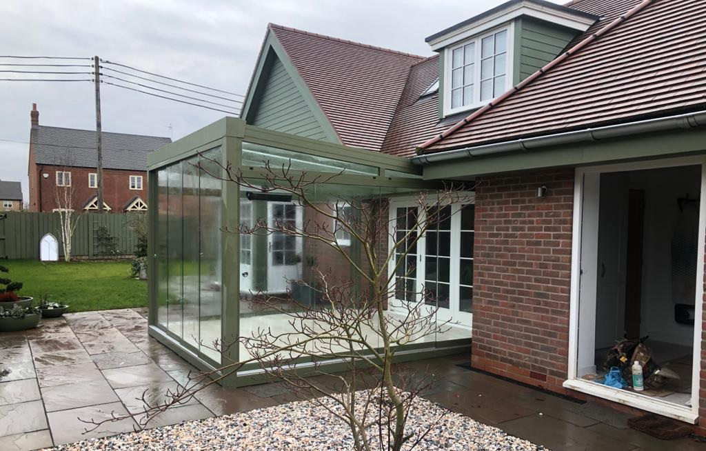 Reverse pitch sunroom